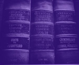 "three old volumes of the law reference book ""american record"" tinted purple"