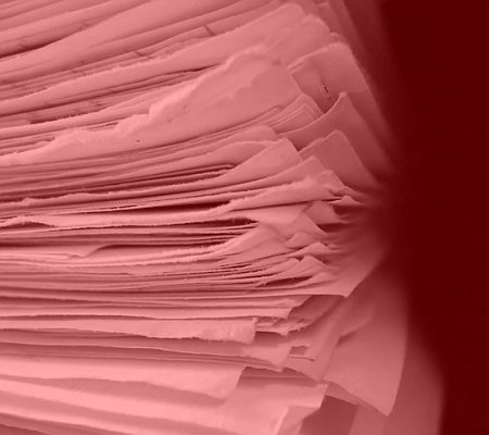 stack of papers tinted red